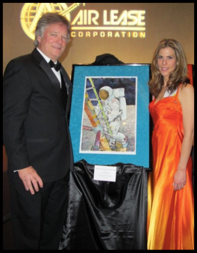 "Rick Armstrong and Michelle Rouch with Artwork ""We Came for All Mankind"""